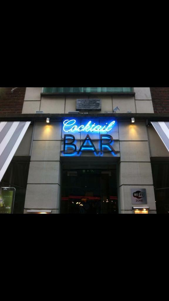 Cocktail Bar Neon Shopfront Sign blue dark blue glass