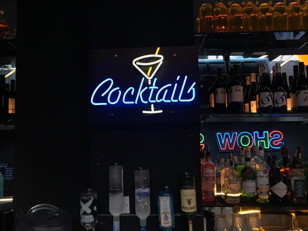 cocktails sign white blue light tube
