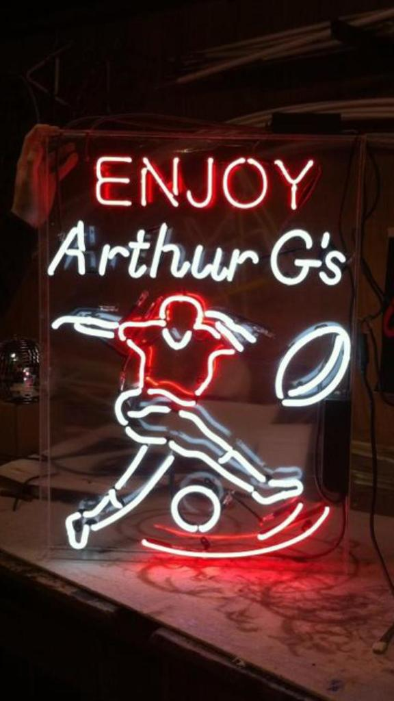 Enjoy Arthur Gs Neon Sign with a Rugby Player for Guiness Ireland