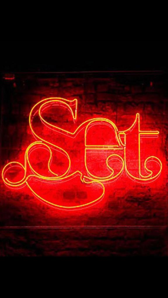 Neon Sign with the lettering Set in Red
