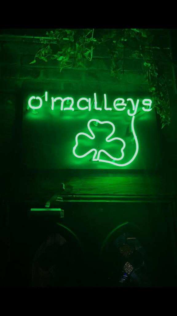 o malleys shamrock green design neon