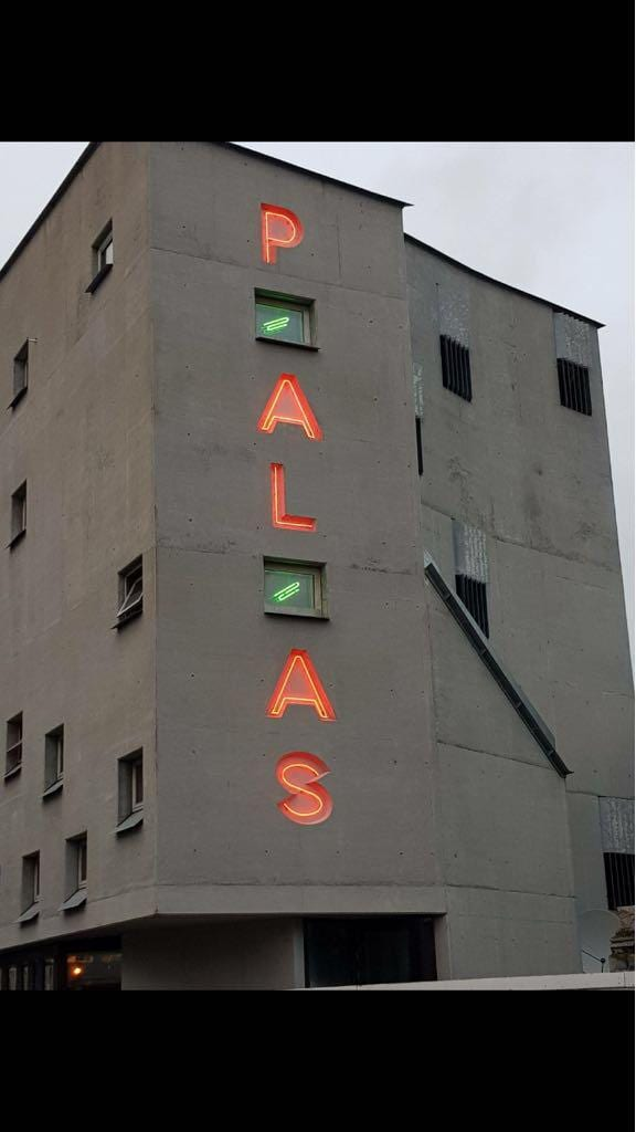 palas neon lighting side of building