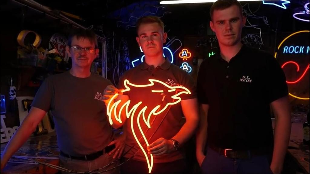 BL Neon Team holding the Phoenix Neon Light