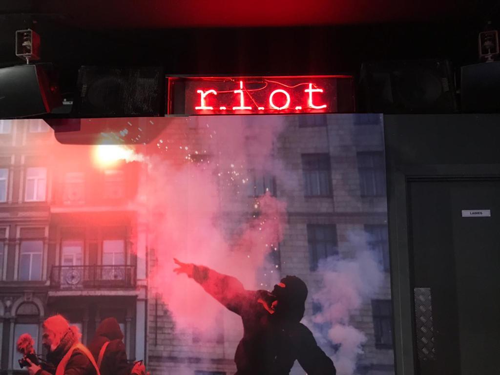 riot logo neon lighting